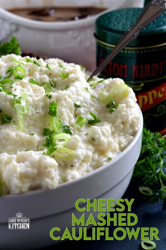 A mashed potato substitute that's health conscious and free of butter and heavy cream.  Cheesy Mashed Cauliflower is creamy, flavourful, and delicious without all of the calories and extra fat. The addition of fresh green onions adds a crisp, refreshing taste. #cauliflower #creamcheese #mashedcauliflower #potatoalternative #mashed #thanksgiving #sidedish