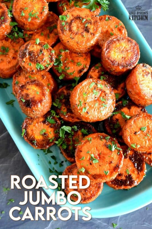 An easy, rustic, and budget friendly side dish that looks like a million bucks!  Roasted Jumbo Carrots are browned and charred on the outside, but soft and tender on the inside. Perfectly seasoned and a great side dish to serve with almost any meal! #carrots #sides #vegetables #thanksgiving #roasted #roastedvegetables