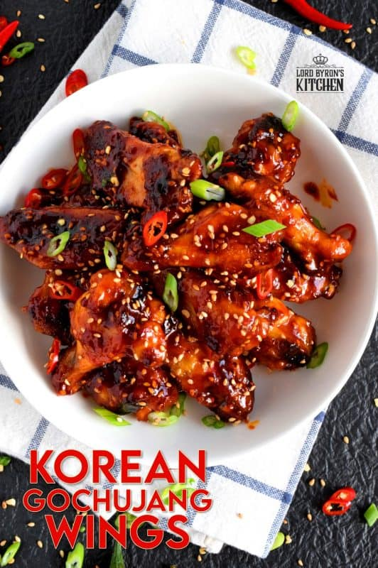 Perfectly baked chicken wings which have been tossed in a spicy sauce!  Korean Gochujang Chicken Wings are completely addictive! These hit all of your taste buds with a little bit of spice, heat, sweet, and salt! #korean #gochujang #chicken #wings #spicy
