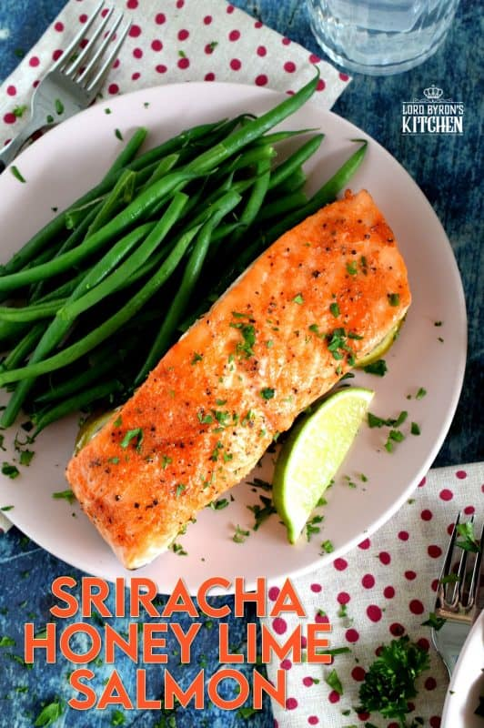 Slightly sweet with a little tartness, Sriracha Honey Lime Salmon is oven baked on a bed of sliced limes for extra zing and fresh flavour.  The sriracha and honey combine to make a wonderful basting sauce with the perfect balance of sweet and heat. #sriracha #honey #honeylime #salmon #bakedsalmon #spicysalmon