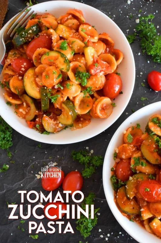 Two of the most common home-grown summer produce are tomatoes and zucchini. Harvest to your hearts' content and prepare copious amounts of this Tomato Zucchini Pasta. It's simple, it's healthy, and it's wonderfully delicious!  Just one taste, and this will be a 30-minute recipe you will want to prepare repeatedly! #pasta #tomatoes #zucchini #meatlessmonday #vegetarian #summer #cherry #fresh #orecchiette #familyrecipes