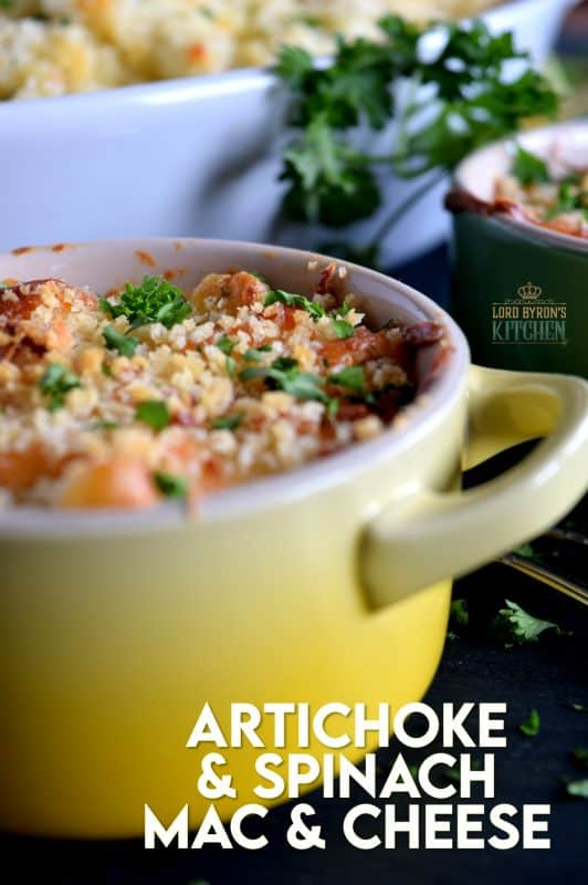 There's nothing wrong with regular mac and cheese, but it simply cannot compare to this Ultimate Spinach and Artichoke Mac and Cheese!  It is the cheesiest and the creamiest, with a crispy, crunchy crumb topping. Make no mistake, this cannot be found in a box at the grocer! #macandcheese #artichoke #spinach #ultimate #pasta #spinachandartichoke