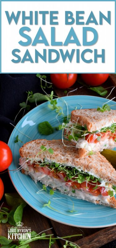 When you mash canned white beans, and combine them with mayo and seasonings, the result is a creamy and tasty vegetarian salad sandwich spread. Top that sandwich with sliced tomatoes, fresh microgreens, and watercress for a very healthy and hearty lunch. #canned #beans #smashed #salad #sandwich #vegetarian #meatless