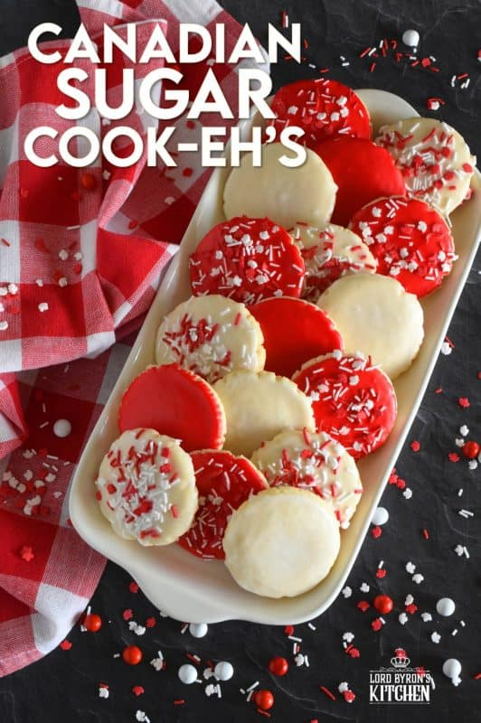 This recipe consists of a melt-in-your-mouth sugar cookie base, topped with a thin, sugary glaze, and festive sprinkles. Canadian Sugar Cook-eh's are brightly coloured with vivid red and white sweets to keep your Canada Day celebrations full of high energy! #canadianrecipes #redandwhite #sugarcookies #canadaday