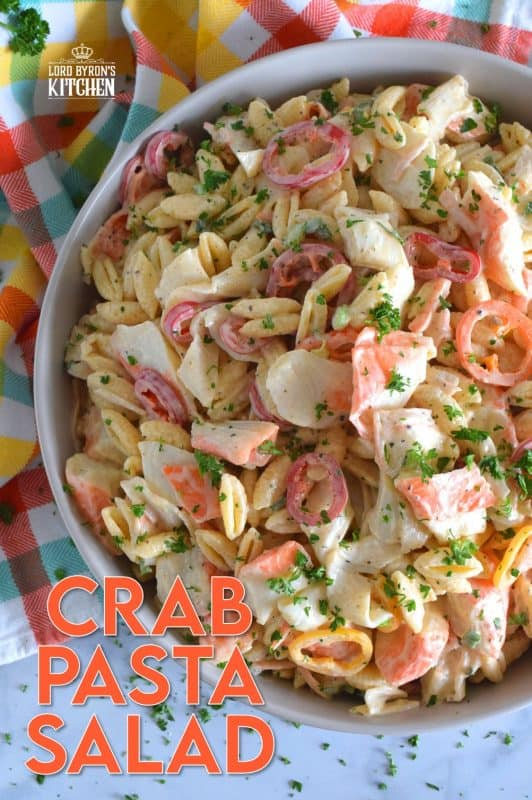 Flaked crab is paired with pasta and peppers in this Crab Pasta Salad. It is tossed in a creamy and tangy dressing made with mayonnaise, old bay seasoning, celery salt, and more. A great make-ahead salad best served slightly chilled with your favourite grilled beef! It's surf and turf - summer style! #pastasalad #salad #pasta #seafood #crab #imitationcrab