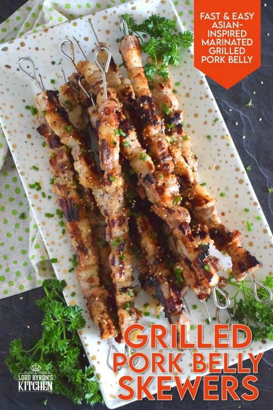 Marinated pork belly is skewered and grilled to perfection in this Asian-inspired recipe. The marinade tenderizes the pork and draws out some of the fat so that the pork can be grilled quickly on a high heat while keeping the meat moist and delicious. #pork #porkbelly #grilledpork #asian #skewers #kebabs #grilling #summer