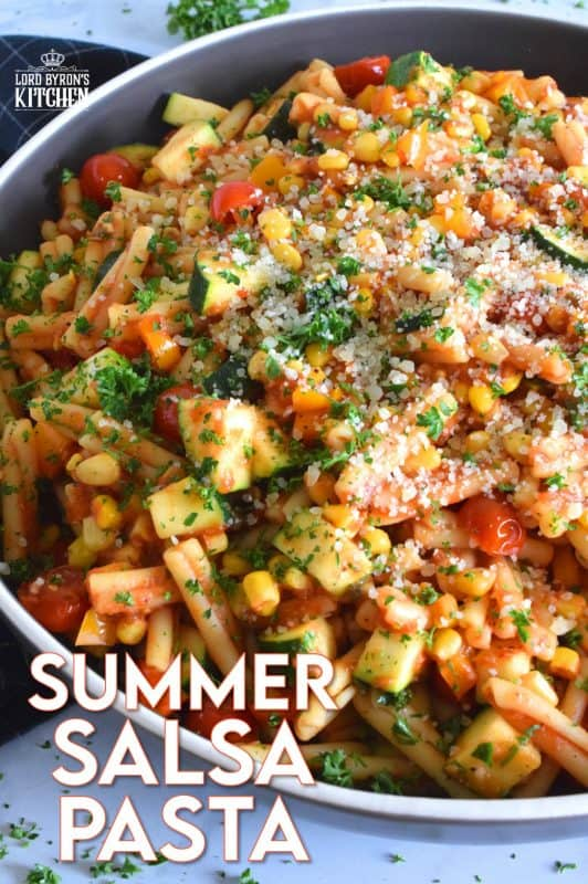 Prepared with fresh tomatoes, corn, and zucchini, Summer Salsa Pasta comes together in less than 25 minutes. With a bright, fresh, flavour, this pasta dish relies heavily on some of the best that summer has to offer. Top with parmesan cheese and grab a fork; dinner is ready! #salsa #summersalsa #pasta #summerpasta #zucchini #corn #tomatoes #meatless