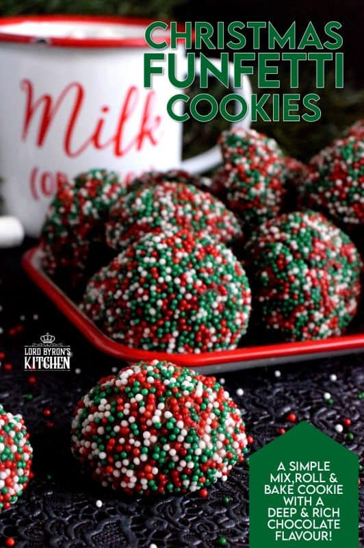 A simple mix, roll, and bake cookie with a deep, rich chocolate flavour.  Christmas Funfetti Cookies are ideal for holiday baking with kids! These make a lovely gift idea too, because they can be packaged without much risk of crumbling! #christmas #holiday #baking #cookies #funfetti #chocolate #sprinkles #kids