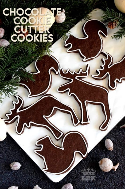 Christmastime is synonymous with cookie cutter cookies.  Crispy Chocolate Cookie Cutter Cookies are a simple and inexpensive way to add a special touch to a deliciously classic cookie. Besides, who doesn't love playing with cookie cutters and icing at Christmastime!? #christmas #holiday #baking #chocolate #cookie #cutter #cookies