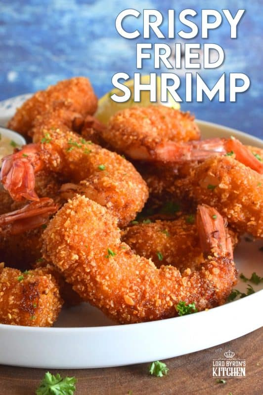 Looking for crunch factor? Look no further! Crispy Fried Shrimp have perfectly cooked succulent shrimp on the inside and a big-bite worthy crunch on the outside. This is most definitely a repeat recipe! #shrimp #friedseafood #friedshrimp #battered #crispy #seafood