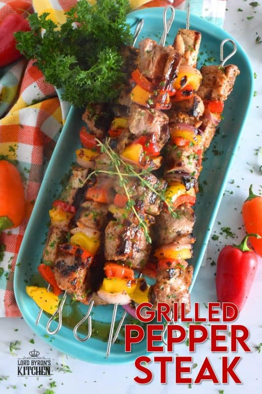Marinated and skewered, Grilled Pepper Steak is simple, yet so delicious! The marinade tenderizes the steak while the peppers and red onions help to flavour it. Perfectly prepared to medium-well in about twelve minutes! #steak #bbq #kebabs #skewers #beef #summergrilling #grilled