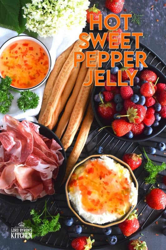 Possibly considered to be more of an appetizer or a dip, Hot Sweet Pepper Jelly is easy to prepare and makes for a quick and easy appetizer or ingredient. These are canned using the water bath canning method, which couldn't be easier! This post will walk you through every step. #hotpepperjelly #hotandsweet #sweetpeppers #canning #preserves #jelly #cannedjelly
