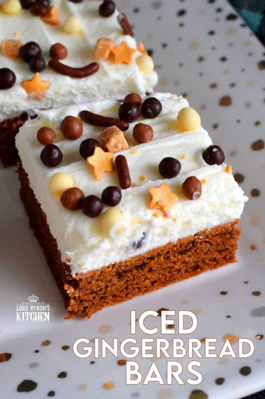 Soft, moist, and fudge-like; these Iced Gingerbread Bars taste like the familiar flavours of Christmas, but have the texture of a dense, chocolaty brownie. #christmas #holiday #baking #gingerbread #bars #squares #cookies