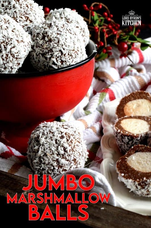 A popular Christmastime treat in Newfoundland, Jumbo Marshmallow Balls are cookies that make you feel as though you were eating candy. Serve whole or sliced, but best when frozen! A thick coconut and chocolate mixture is formed around a jumbo marshmallow and rolled in more coconut. This is one serious cookie! #newfoundland #traditional #jumbo #chocolate #marshmallow #balls #christmas #nobake #holiday
