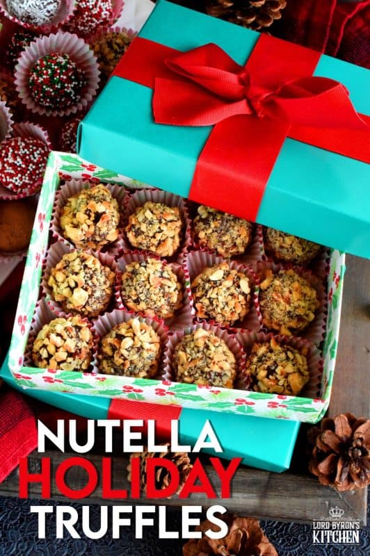 Holiday baking should be delicious, indulgent, and easy!  Nutella Holiday Truffles are all of those things and more! They're delectable, luxurious, succulent, tantalizing, and delightful! If that description doesn't convince you to make this, nothing will! #christmas #holiday #nobake #truffles #balls #nutella