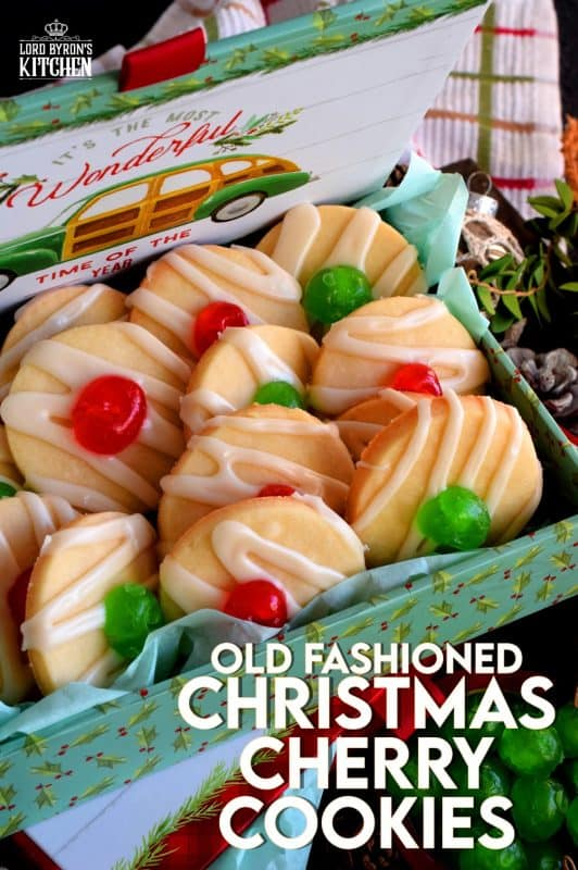 Old Fashioned Christmas Cherry Cookies are sugary, buttery, shortbread cookies, topped with royal icing and a festive candied cherry center. Not only do they look vintage, they also look really delicious, don't they!? #shortbread #cookies #christmas #holiday #baking #cherry #oldfashioned #glazed