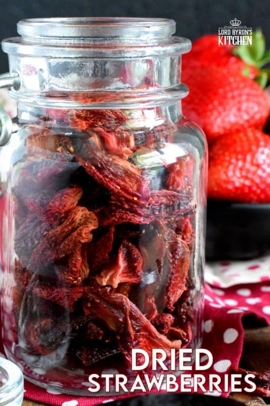 Strawberry season is short. Make the season last with Oven Dried Strawberries that you can use for months to come. Add these to cereal, granola, scones, or salads! #dried #dehydrated #oven #strawberries #strawberry
