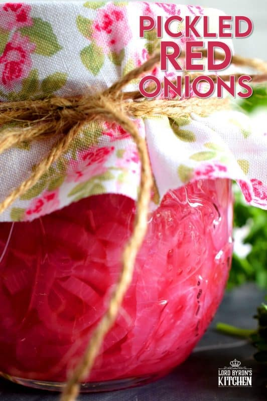 Pickled Red Onions are not only gorgeous to look at, they are delightfully tasty as well! Bright and crisp, a great addition to almost anything, and super easy to make; you'll want to keep a jar in your fridge at all times! #pickled #redonions #red #onions #preserved