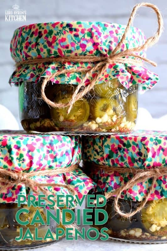 Preserved Candied Jalapenos are bite-sized morsels of heat and sweet - these are highly addictive, easy to prepare, and no canning experience is needed. Makes for a great bring-along gift too! #jalapenos #pickled #preserved #waterbath #canning
