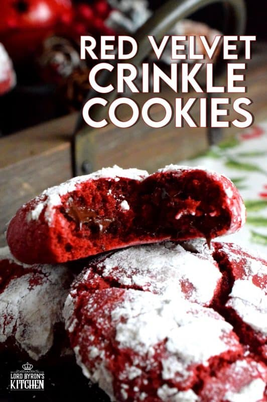 A delicious red cookie dough is rolled into powdered sugar to create these puffy, moist, Red Velvet Crinkle Cookies – the red and white lends itself well to holiday baking! #christmas #holiday #cookies #baking #red #velvet #redvelvet