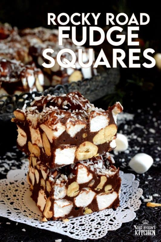Homemade sweet treats can't get any easier than a fudge recipe.  Rocky Road Fudge Squares combines traditional Rocky Road ingredients like chocolate, nuts, and marshmallows. These are so delicious when served chilled right from the fridge! #christmas #holiday #nobake #recipes #chocolate #rockyroad