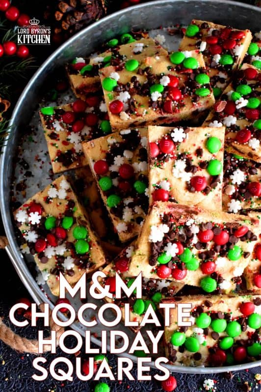 Fast, simple, and easy – just the way Christmas baking should be!  Sheet Pan M&M Chocolate Holiday Bars are festive, fun, and family-friendly! Baking cookies in a sheet pan like this, is much faster than baking one tray at a time! #christmas #holiday #baking #cookies #candy #m&m #sheetpan