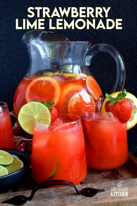 A refreshing summer drink made with simple syrup, whole strawberries, lime and lemon juice. If you're looking to up your lemonade game, this one is for you! #strawberry #lime #limeade #lemonade #juice #summer #drink #punch