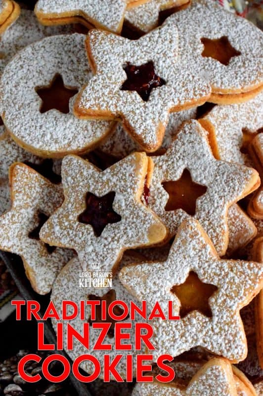 Christmas is all about tradition, both the new traditions and the old.  This Traditional Christmas Linzer Cookies recipe, an old world cookie confection, originating in Austria, is a vital part of holiday traditions for many families. Also, they look impressive, but they are so simple to make! #linzer #traditional #christmas #holiday #baking #cookies