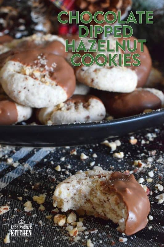 Ground hazelnuts, butter, sugar, and chocolate - what more is there to say? Chocolate Dipped Hazelnut Cookies have deep nutty flavour, a great texture, and bit of indulgence. One batch will never do! #chocolatedipped #hazenut #nut #chocolate #cookies #christmas #holiday #baking