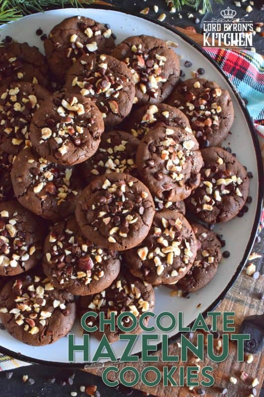 These cookies are slightly crispy on the outside, but with a moist and dense chocolaty center. Loaded with lots of chocolate chips and hazelnuts, Chocolate Hazelnut Cookies taste like very much like eating a big spoon of Nutella in cookie form! #chocolatecookies #hazelnut #christmas #holiday #baking