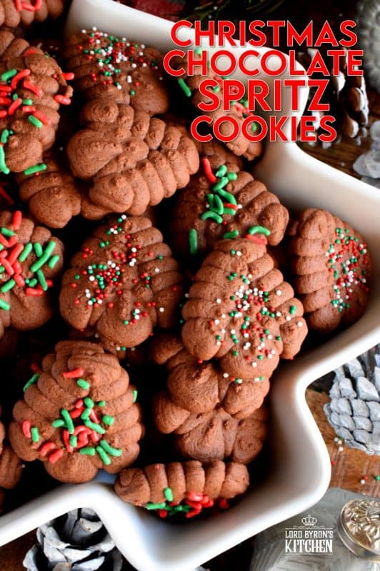 When it comes to baking with the purpose of gift giving, a Christmas Chocolate Spritz Cookie is the best way to go, especially if they have sprinkles! Everyone loves spritz cookies; they're so easy to make and one batch makes a lot of cookies! #spritz #cookies #press #holiday #christmas #chocolate #baking