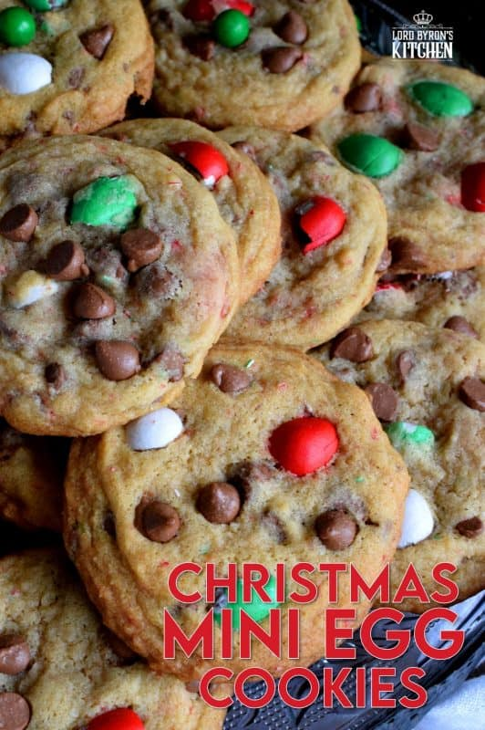 This recipe upgrades classic chocolate chip cookies with Christmas-themed mini eggs - festive, delicious, and addictive too! These cookies are for the serious chocolate lover, because these are loaded to the max with milk chocolate goodness! #cadbury #hershey #eggies #minieggs #christmas #holiday #baking