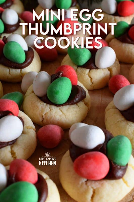 These are made using a classic thumbprint cookie dough, which is stuffed with a creamy chocolate frosting, and topped with mini eggs. There's no doubt that Christmas Mini Egg Thumbprint Cookies will be the first cookie to disappear from your cookie platter! #minieggs #cadbury #hershey #christmas #holiday #baking #thumbprint #cookies