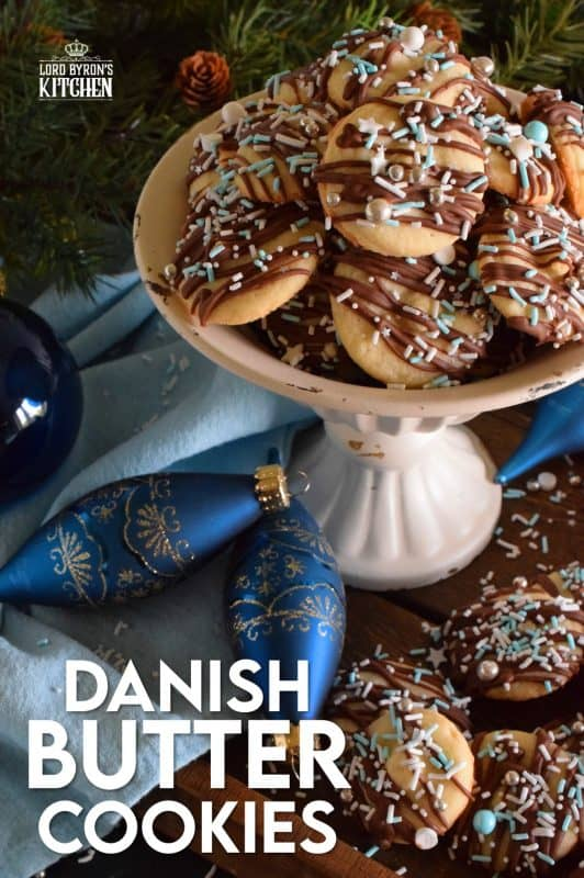 Melt in your mouth Danish Butter Cookies taste just like those cookies in the blue tin at your grandma's house. These are drizzled with milk chocolate, because everything at Christmastime should be over the top! #danish #butter #cookies #christmas #holiday #baking #dansk