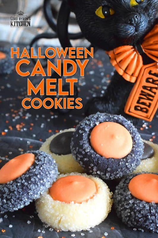 Similar to a classic thumbprint cookie, these Halloween Candy Melt Cookies use candy melts instead of jam. The cookie dough is tinted with food colouring and rolled in sanding sugar, these are all treat and no trick! #halloween #trickortreat #halloweencookies #candymelts #thumbprint