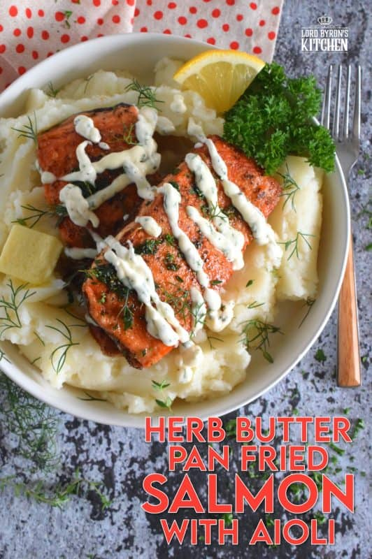 No doubt you have heard the expression that simple is best. In the case of this Herb Butter Pan Fried Salmon with Aioli, the expression most certainly applies! Salmon fillets are perfectly fried and topped with a fresh herb butter and drizzled with a delicious and easy to prepare aioli. #salmon #aioli #panfried #seafood #friedsalmon #butter #friedinbutter