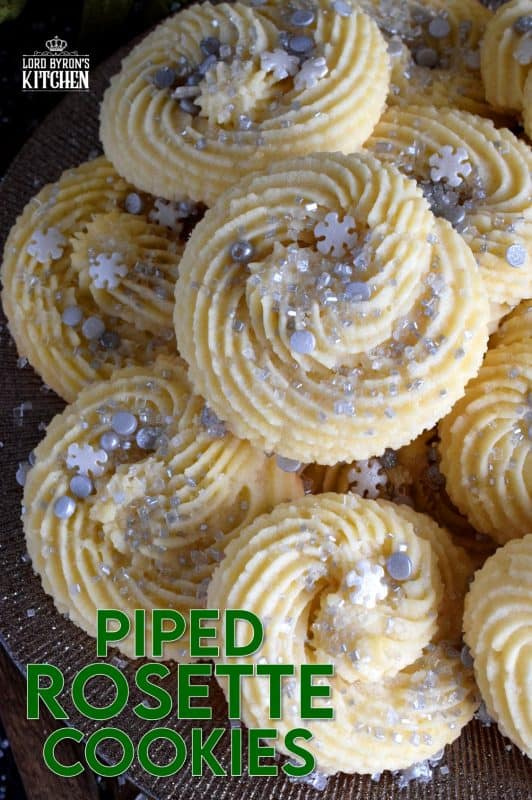 There are no special skills needed to make these gorgeous Holiday Piped Rosette Cookies; they're very impressive, but they're also very easy! These pack well and are great for storing in tins for gift giving!! #rosette #piped #cookies #christmas #holiday #baking