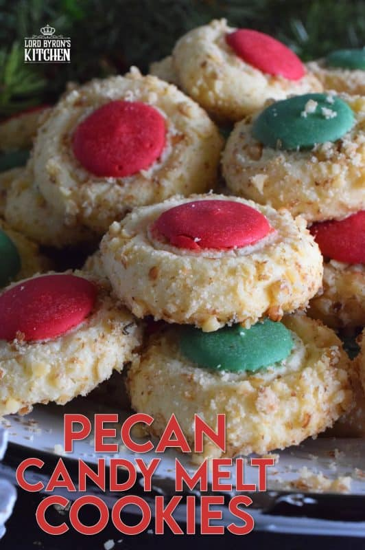 Loaded with chopped pecans, these Pecan Candy Melt Cookies are prepared with cream cheese and topped with a single candy melt. A soft, nutty cookie with just the right amount of sweetness; and cute too! Who says thumbprint cookies must have jam!? #pecan #candymelts #wilton #cookies #christmas #holiday #baking