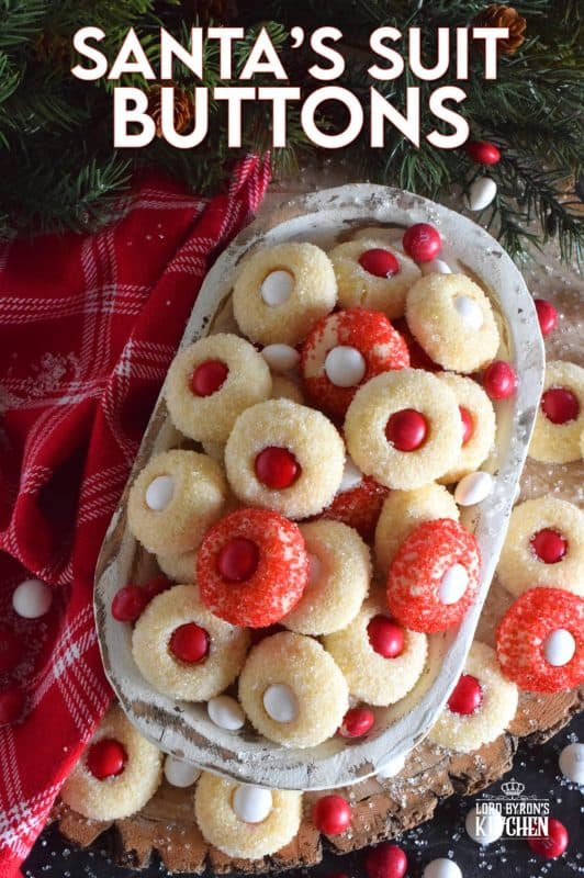 These are miniature, one-bite cookies that are made with Christmas M&M candy centers. Santa's Suit Buttons are a wonderful gift idea, a great baking project with the kids, or bake them alone and save them all for yourself! #santassuit #buttons #cookies #christmas #holiday #baking #kids
