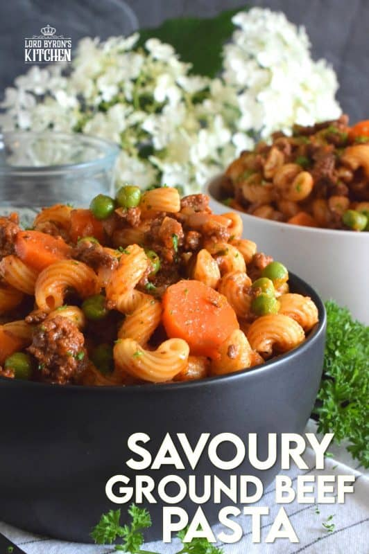 Savoury Ground Beef Pasta is a wonderful fall-inspired dish which is prepared in less than 45 minutes. With ingredients like beef, carrots, onions, tomatoes, peas, and thyme, who could resist? This is not your average ground beef pasta; this is hearty, comforting, and perfect for the cooler months ahead. #groundbeef #pasta #fallrecipes #familyrecipes #hearty #familymeals