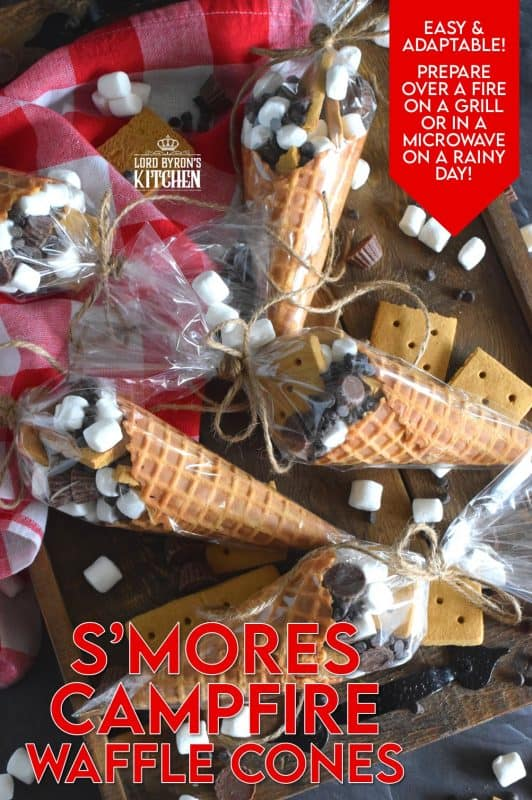 Prepare a bunch of these S'mores Campfire Waffle Cones and wrap them in aluminum foil. Set them onto a grilling rack over the fire for a few minutes and they will be all melty and gooey on the inside, but contained within the cone. No more sticky fingers! Serve the cones with a spoon and enjoy! #campfire #smores #wafflecones #marshmallow