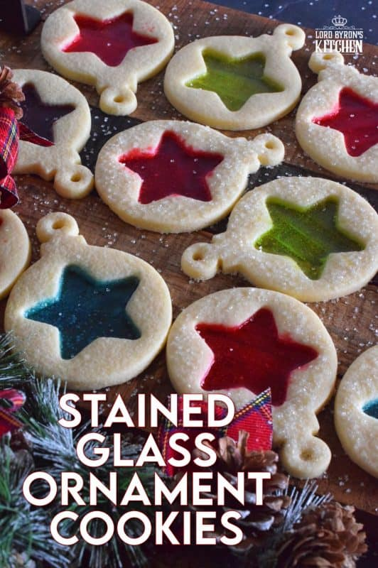 These beautiful Stained Glass Ornament Cookies are made with an easy rolled cookie dough, some glistening sanding sugar, and your favourite flavour of crushed Jolly Ranchers candy. #stainedglass #christmas #holiday #baking #cookies #edible #ornaments #cookiecutters