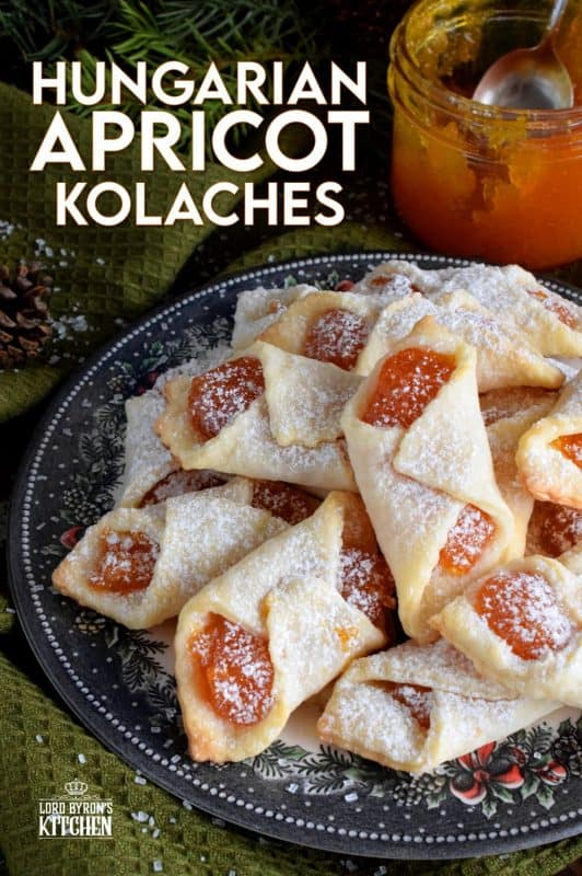 Traditional Hungarian Kolaches are cookies made with a cream cheese dough and filled with apricot jam; they are very common at Christmastime. These are the type of cookies that makes it hard to just have one! Perfect with an afternoon coffee on a stormy winter day! #christmas #holiday #baking #hungarian #kolaches #traditional #cookies #jam