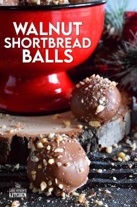 For this cookie, I've taken a shortbread recipe, stuffed it with chopped walnuts, baked them into balls, and dipped them in melted chocolate. Walnut Shortbread Balls are a new take on a Christmas classic! #walnut #shortbread #chocolate #balls #christmas #holiday #baking