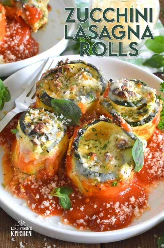 A little lighter on the carbs, Zucchini Lasagna Rolls are prepared by rolling thinly sliced zucchini with spinach, egg, three cheeses, and seasonings. Baked in marinara sauce, don't be fooled by this healthier dish; it is both filling and robust! #zucchini #zucchinirolls #lasagna #lasagnarolls #zucchinilasagna #lowcarb